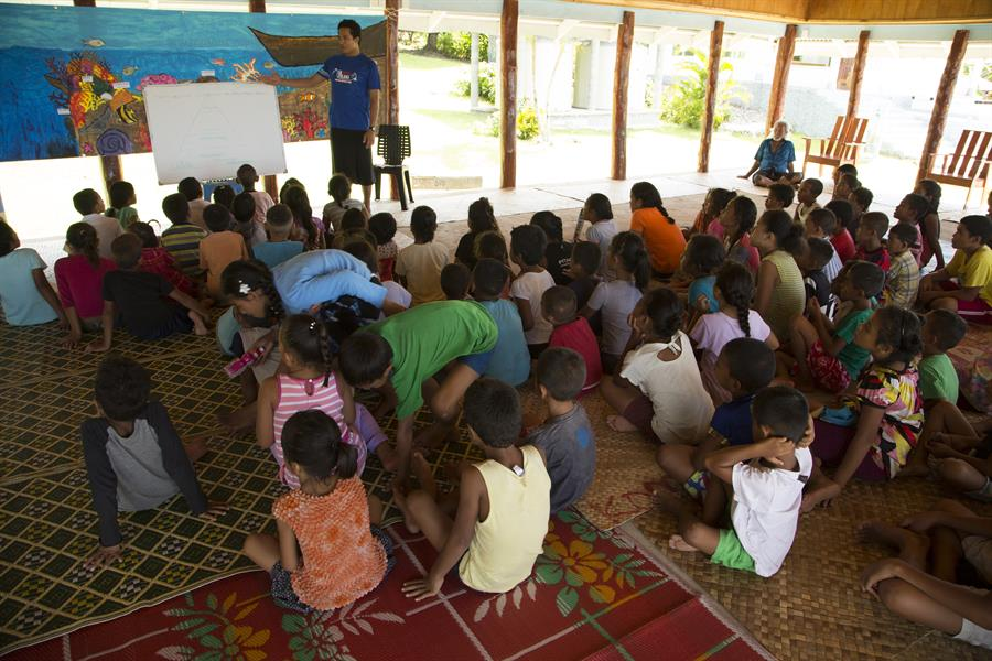 Samoana Folauga - Sacred Ocean Voyage ocean conservation workshop with children at Satitoa village in Upolu Island, Samoa.