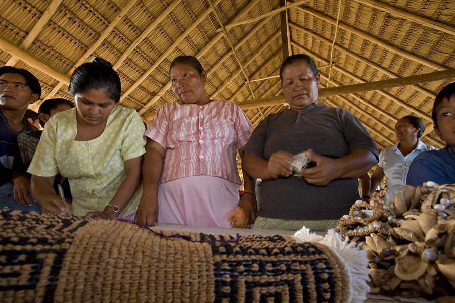 Women sell traditional crafts at the Konashen Community-Owned Conservation Area in Southern Guyana.