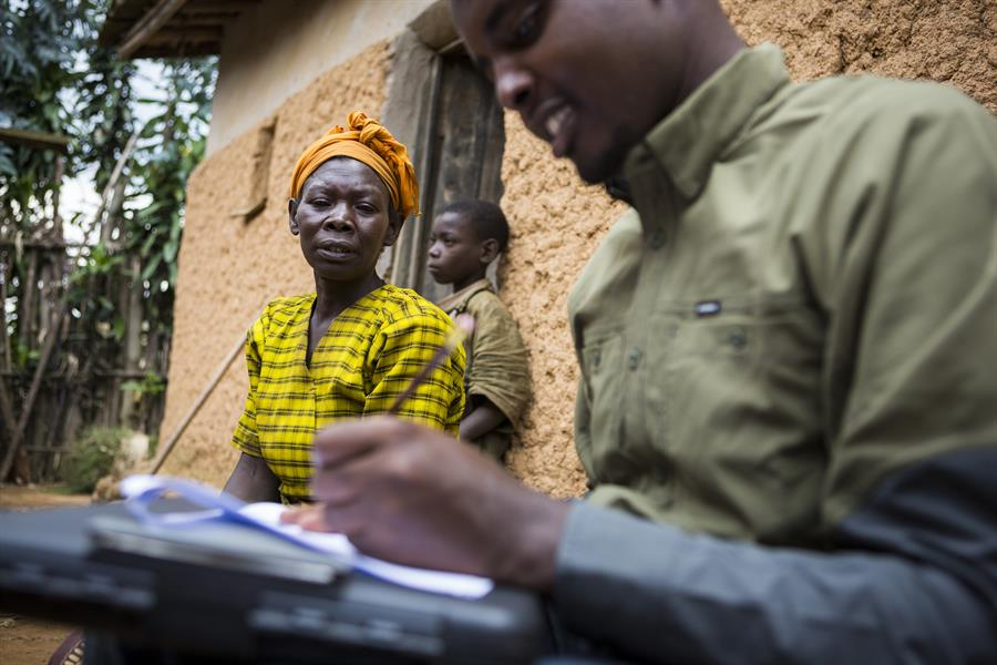 Rodrigue Mugabo completes a household survey with Odette.