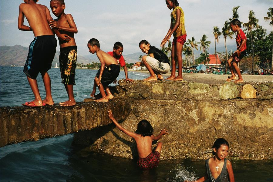 Timorese children playing in water