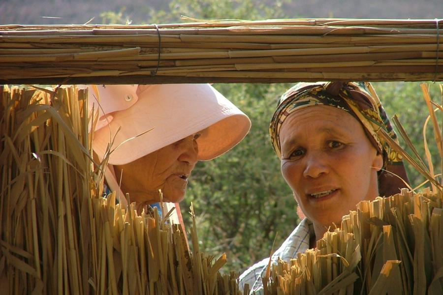 Two Nama Khoi ladies outside their home