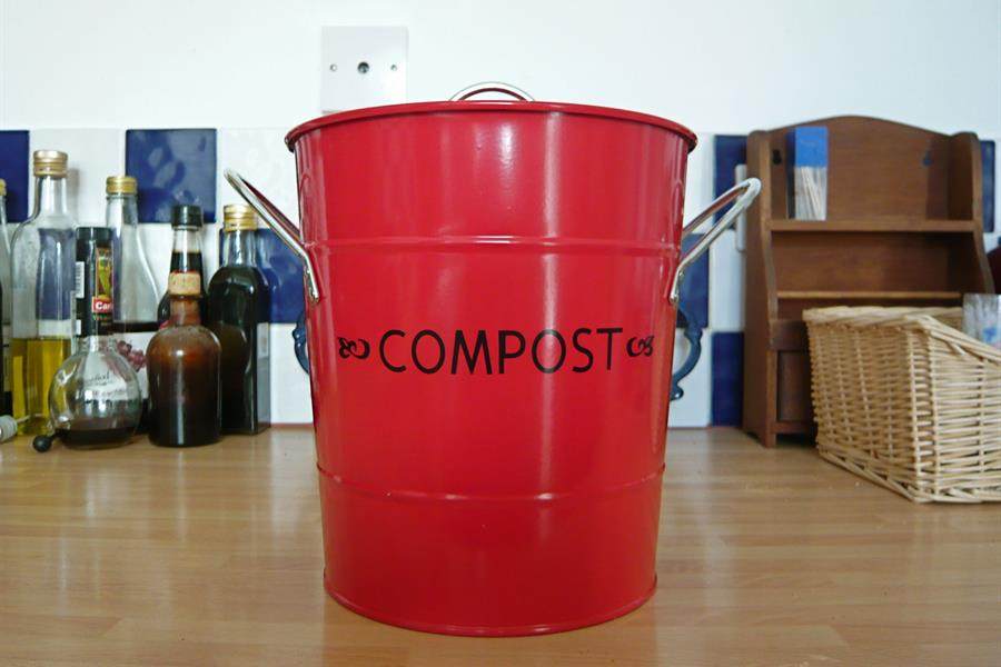 A red compost bin.