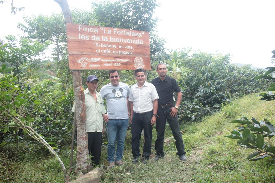 Representatives of Joffrey's Coffee & Tea Company meet with two coffee farmers near the Alto Mayo Protected Forest in San Martin, Peru.
