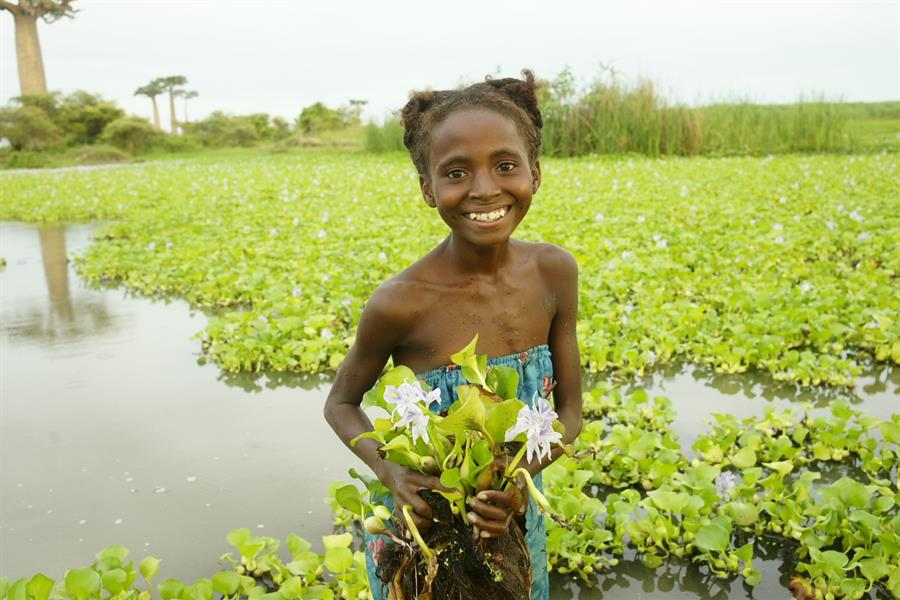 Girl holding flowers in Madagascar