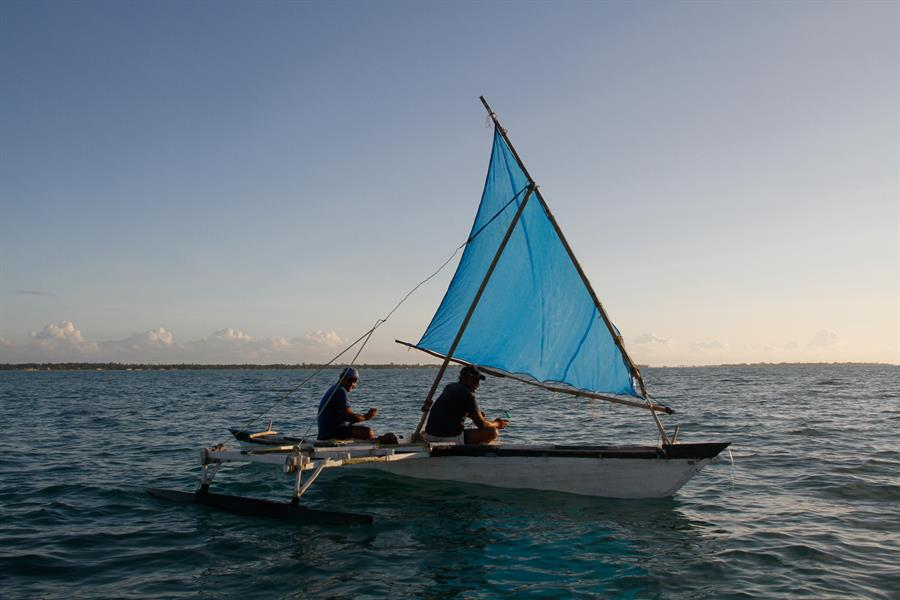 Men in boat off coast of Kiribati