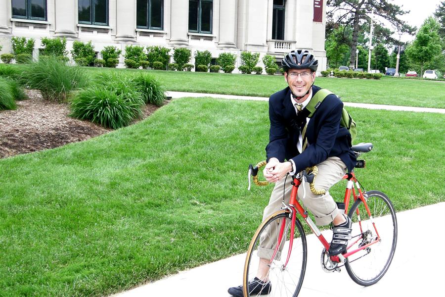 Man biking to work on Bike to Work Day