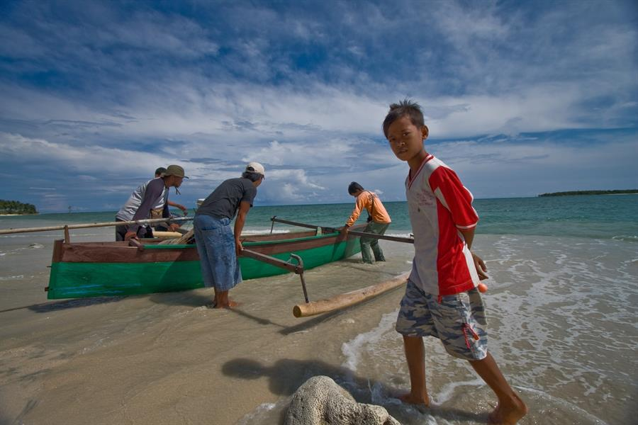 A canoe is launched off the coast of Teku in Central Sulawesi, Indonesia.