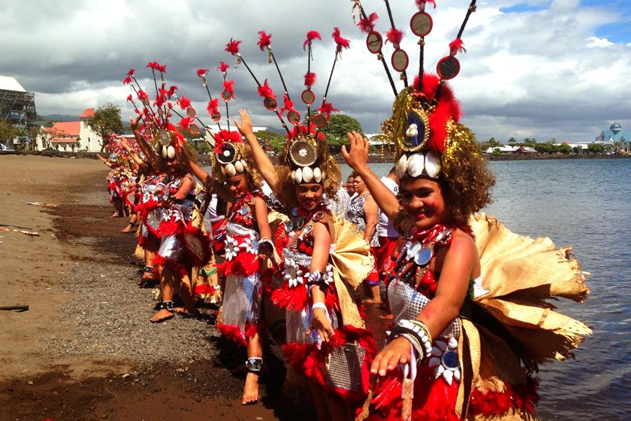 Dancers welcome the Hokule'a (traditional Polynesian sailing vessel) into port in Apia, Samoa.