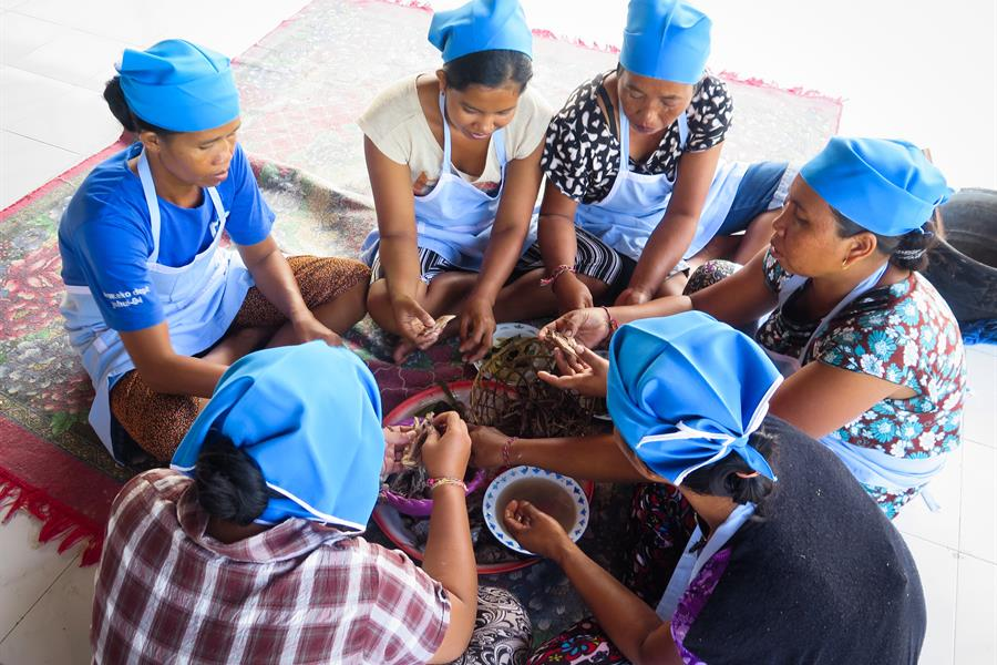The Women in Seraya Timur village are making processed fish products.